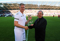 Alan Tate receives an award by former manager Brian Flynn during the Swansea Legends v Manchester United Legends at The Liberty Stadium, Swansea, Wales, UK. Wednesday 09 August 2017