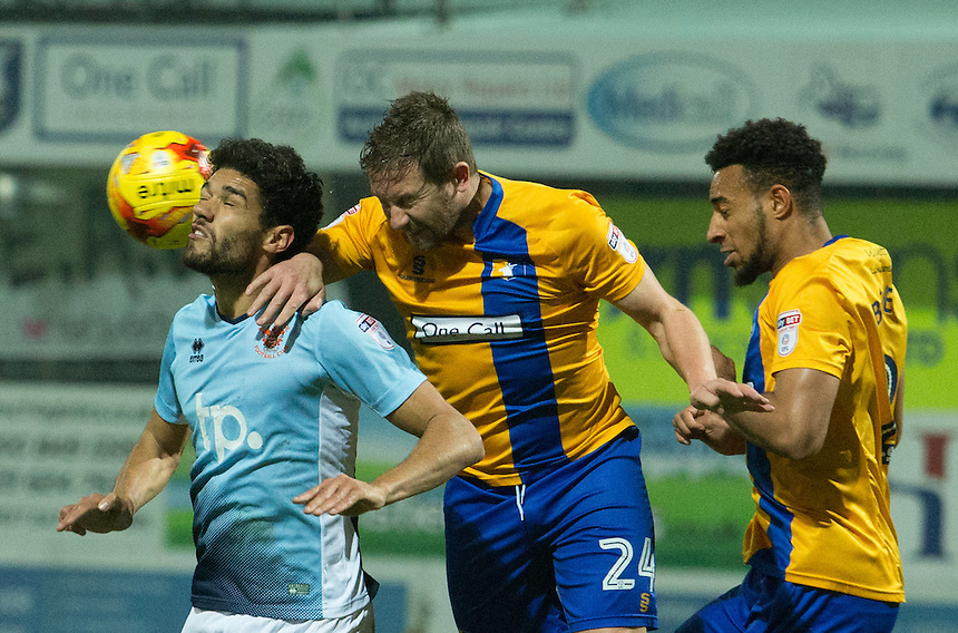 Kelvin Mellor of Blackpool goes up for a header against Jamie McGuire of Mansfield Town<br /> <br /> Photographer James Williamson/CameraSport<br /> <br /> The EFL Sky Bet League Two - Mansfield Town v Blackpool - Tuesday 22nd November 2016 - One Call Stadium - Mansfield<br /> <br /> World Copyright &copy; 2016 CameraSport. All rights reserved. 43 Linden Ave. Countesthorpe. Leicester. England. LE8 5PG - Tel: +44 (0) 116 277 4147 - admin@camerasport.com - www.camerasport.com