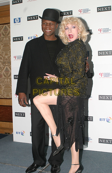 CHRIS EUBANK & FAITH BROWN.Breathing Life Awards - Presented By The Cystic Fibrosis Trust. Royal Lancaster Hotel, London.April 29th, 2004.full length, full-length, leg, posing, slit, split.www.capitalpictures.com.sales@capitalpictures.com.© Capital Pictures.