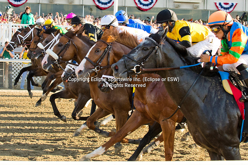 The field passes the stands for the first time in the Belmont S. (Grade I) on Belmont Stakes Day at Belmont Park in Elmont, New York on June 7, 2013.