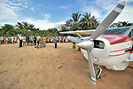 Residents of the Congolese village of Minga gather at the community's airestrip to welcome the crew of a United Methodist mission airplane.