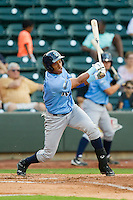 Yem Prades (12) of the Wilmington Blue Rocks follows through on his swing against the Winston-Salem Dash at BB&T Ballpark on August 3, 2013 in Winston-Salem, North Carolina.  The Blue Rocks defeated the Dash 4-2.  (Brian Westerholt/Four Seam Images)