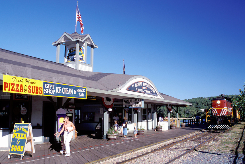 New Hampshire, train station, Weirs Beach, NH, Winnipesaukee Railroad train pulls up to Weirs Station on Lake Winnipesaukee at Weirs Beach.