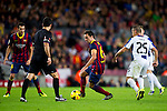 FC Barcelona's Xavi Hernandez (center) protects the ball from RCD Espanyol's Gabriel Torje (right) in front of referee Carlos Velasco Carballo (2nd left) during La Liga 2013-2014 match. November 1, 2013. (ALTERPHOTOS/Alex Caparros)