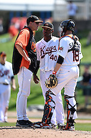 Frederick Keys pitching coach Kennie Steenstra (21) talks with pitcher Mychal Givens (40) and catcher Wynston Sawyer (18) during a game against the Carolina Mudcats on April 26, 2014 at Harry Grove Stadium in Frederick, Maryland.  Carolina defeated Frederick 4-2.  (Mike Janes/Four Seam Images)
