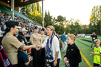 Seattle, Washington -  Sunday, September 11 2016: Seattle Reign FC Co-Owner, Teresa Predmore, greets military guests prior to a regular season National Women's Soccer League (NWSL) match between the Seattle Reign FC and the Washington Spirit at Memorial Stadium. Seattle won 2-0.