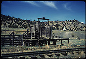 D&amp;RGW stock chute at Gato with church in background.<br /> D&amp;RGW  Gato (Pagosa Junction), CO