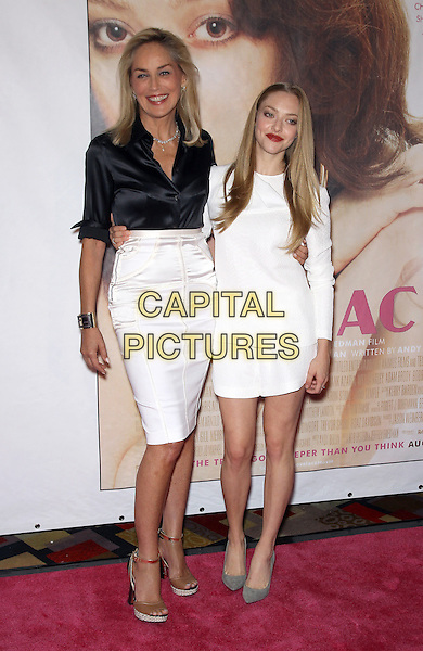 Sharon Stone, Amanda Seyfried<br /> 'Lovelace' VIP Screening at Planet Hollywood Resort and Casino, Las Vegas, NV., USA.<br /> August 4th, 2013<br /> full length black silk satin blouse white skirt dress     <br /> CAP/ADM/MJT<br /> &copy; MJT/AdMedia/Capital Pictures