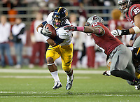 October 13th, 2012: California's Isi Sofele runs to avoid being tackled by Washington State defender during a game at Martin Stadium in Pullman, Wa    California defeated Washington State 31 - 17