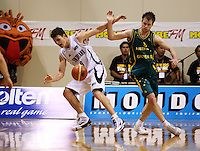 Boomers guard Brad Newley fouls Kirk Penney during the International basketball match between the NZ Tall Blacks and Australian Boomers at TSB Bank Arena, Wellington, New Zealand on 25 August 2009. Photo: Dave Lintott / lintottphoto.co.nz