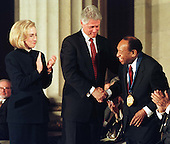 United States President Bill Clinton and first lady Hillary Rodham Clinton present the National Medal of Arts to Lionel Hampton at the Andrew W. Mellon Auditorium in Washington, D.C. on January 9, 1997..Credit: Ron Sachs / CNP