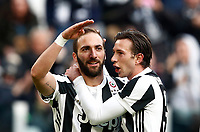 Calcio, Serie A: Juventus - Sassuolo, Torino, Allianz Stadium, 4 Febbraio 2018. <br /> Juventus' Gonzalo Higuain (l) celebrates after scoring his first goal in the match with his teammate Federico Bernardeschi (r) during the Italian Serie A football match between Juventus and Sassuolo at Torino's Allianz stadium, February 4, 2018.<br /> UPDATE IMAGES PRESS/Isabella Bonotto