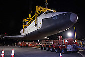 The space shuttle Enterprise is lowered onto a transport vehicle after being demated from the NASA 747 Shuttle Carrier Aircraft (SCA) at John F. Kennedy (JFK) International Airport in Jamica, New York, Sunday, May 13, 2012. The shuttle will be placed on a barge that will move by tugboat up the Hudson River to the Intrepid Sea, Air & Space Museum in June. The shuttle will be lifted by crane and placed on the flight deck of the Intrepid, where it will be on exhibit to the public starting this summer in a temporary climate-controlled pavilion..Mandatory Credit: Kim Shiflet / NASA via CNP
