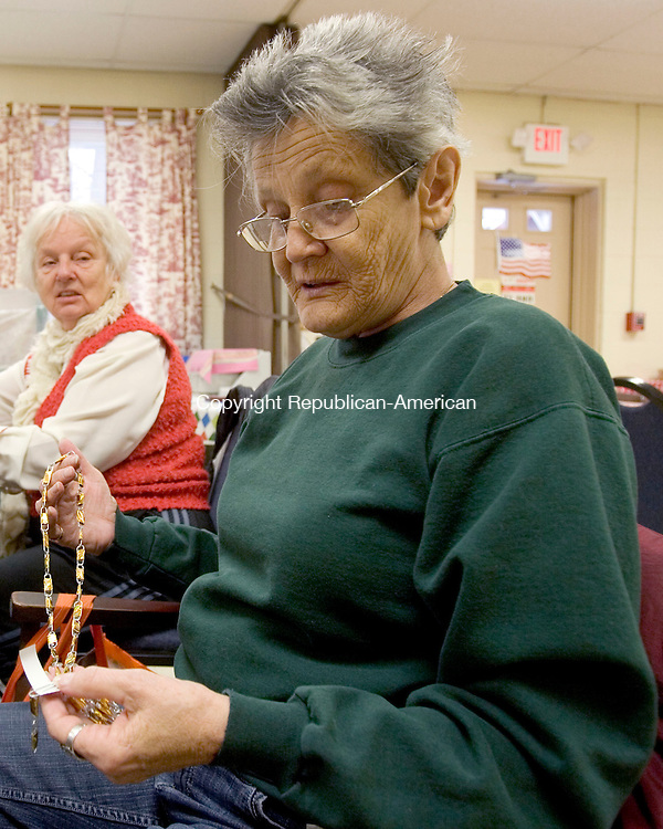NAUGATUCK CT. 27 January 2014-012714SV08-Bernice Niro of Naugatuck works on a hand crafted necklace during a craft and stitch session at the Senior Center in Naugatuck Monday. The seniors work all year on the handmade items for the Holiday Bazaar the first week of December.<br /> Steven Valenti Republican-American