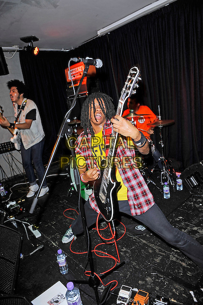 Isaiah Radke and Dee Radke of Radkey <br /> performing in concert, The Blackeart, Camden, London, England. <br /> 17th October 2013<br /> on stage in concert live gig performance performing music full length white jean denim jacket sleeveless bass guitar red check shirt yellow <br /> CAP/MAR<br /> &copy; Martin Harris/Capital Pictures