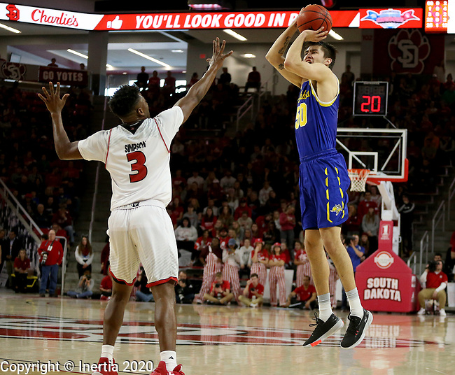 VERMILLION, SD - JANUARY 19: David Wingett #50 of South Dakota State Jackrabbits shoots over Triston Simpson #3 of South Dakota Coyotes at the Sanford Coyote Center on January 19, 2020 in Vermillion, South Dakota. (Photo by Dave Eggen/Inertia)