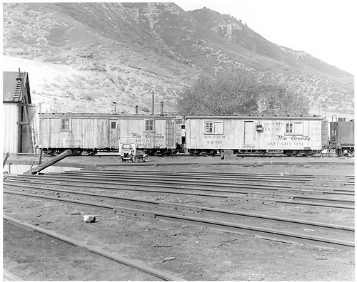 Kitchen/diner car 04466 and sectionmen's bunk car 04965 assigned to Rotary OM at Durnago (plus speeder).<br /> D&amp;RGW  Durango, CO  Taken by Morse, Ron - 5/23/1965
