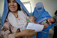 AFGHANISTAN, 06.2008, Tscharikar/Charikar. Selbst im Krankenhaus wird weiter die Burka getragen.   Not even in the hospital do women give up wearing their burkas.<br /> © Marzena Hmielewicz/EST&OST