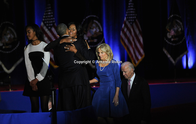 President Barack Obama joined on stage by his daughter Malia, First Lady Michelle Obama and Vice-President Joe Biden's wife Jill and Biden after President Obama gave his farewell address to a crowd of thousands and the nation during his farewell address at McCormick Place in Chicago, Illinois on January 10, 2017.