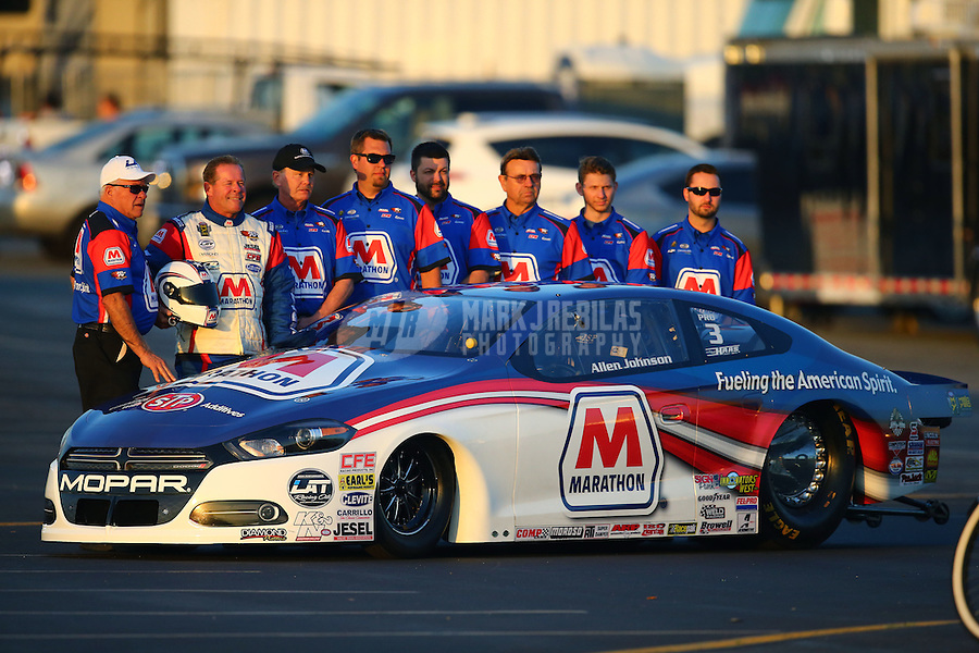 Feb 12, 2016; Pomona, CA, USA; NHRA pro stock driver Allen Johnson with crew during qualifying for the Winternationals at Auto Club Raceway at Pomona. Mandatory Credit: Mark J. Rebilas-USA TODAY Sports