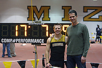Brian Hancock poses with Missouri native, Olympian, and former American Record Holder Jeff Hartwig after Hancock broke his own school record in the pole vault.