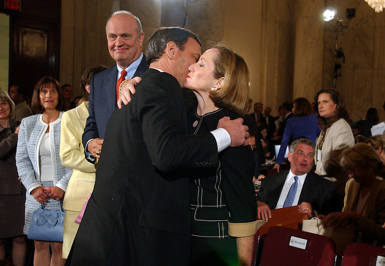 Judge John G. Roberts Jr., hugs his wife Jane Sullivan Roberts, after the first day of the Senate Judiciary Committee hearing on his nomination for the chief justice of the United States.