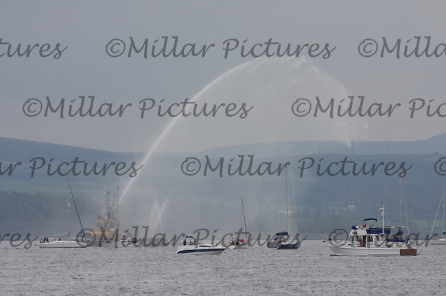 A water plume from the flotilla watching the Tall Ships Race 2011 leaving Greenock