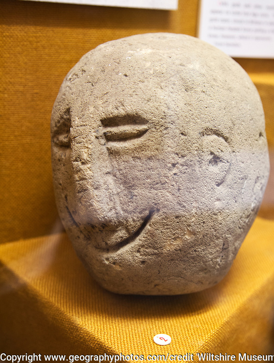 Human face carved onto stone. With permission of Wiltshire Museum, Devizes, England, UK