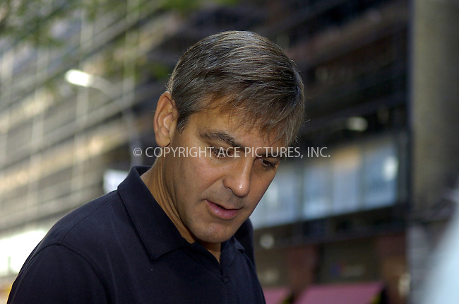 WWW.ACEPIXS.COM ** ** **EXCLUSIVE!!! FEE MUST BE NEGOTIATED BEFORE USE!!!***....NEW YORK, SEPTEMBER 21, 2005....George Clooney really goes out of his way for his fans by signing autographs and posing for numerous pictures with fans. Accomplishing the task with coffee in hand, Clooney meets and greets most everyone before entering his midtown hotel.....Please byline: Philip Vaughan -- ACE PICTURES... *** ***  ..Ace Pictures, Inc:  ..Craig Ashby (212) 243-8787..e-mail: picturedesk@acepixs.com..web: http://www.acepixs.com