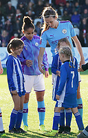 20191027 - Boreham Wood: Manchester City's Demi Stokes (left) and Jill Scott (right) are pictured with players' mascots at the line up of the Barclays FA Women's Super League match between Arsenal Women and Manchester City Women on October 27, 2019 at Boreham Wood FC, England. PHOTO:  SPORTPIX.BE | SEVIL OKTEM