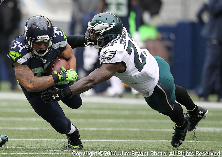 Seattle Seahawks Running back Thomas Rawls (34) drives for extra yardage before being tackled by Philadelphia Eagles safety Malcolm Jenkins (27)<br /> at CenturyLink Field in Seattle, Washington on November 20, 2016.  Seahawks beat the Eagles 26-15.   &copy;2016. Jim Bryant Photo. All Rights Reserved.