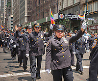 Members of the Gay Officers Action League march in the 44th annual Lesbian, Gay, Bisexual and Transgender Pride Parade on Fifth Avenue in New York on Sunday, June 30, 2013. The turn out for the parade was especially large with the recent Supreme Court decision overturning the Defense of Marriage Act (DOMA) and California's Proposition 8.  (© Richard B. Levine)