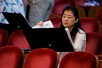 Jury member Dan Yu of China looks through papers during Stage III at the 11th USA International Harp Competition at Indiana University in Bloomington, Indiana on Wednesday, July 10, 2019. (Photo by James Brosher)