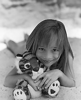 Girl with Stuffed Tiger, Sandy Beach, Oahu, Hawaii, USA.