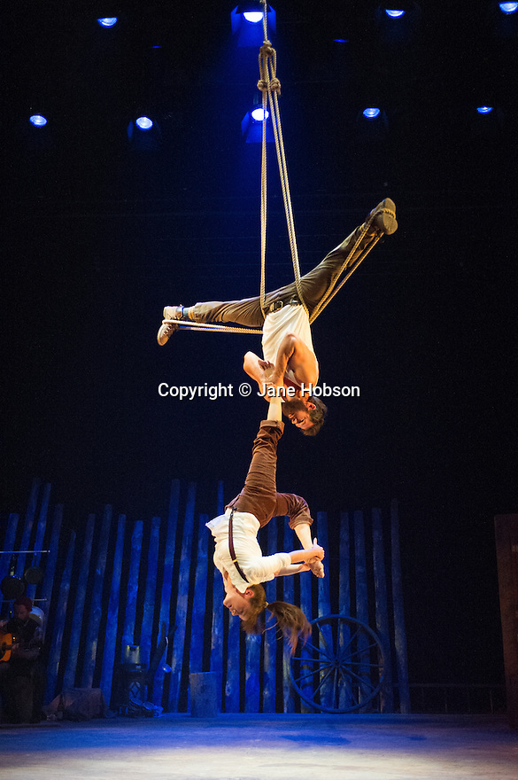 London, UK. 11.07.2013. Southbank Centre presents TIMBER! by Cirque Alfonse. Three generations of Quebecois circus family premiere their UK debut show. Picture shows: Julie Carabinier-Lepine and Jonathan Casaubon. Photograph © Jane Hobson.