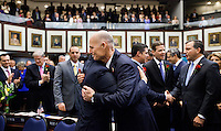 TALLAHASSEE, FLA. 3/4/14-Gov. Rick Scott, center right, embraces his Lt. Gov. Carlos Lopez-Cantera, during the opening day of the legislative session, March 4, 2014 at the Capitol in Tallahassee.<br /> <br /> COLIN HACKLEY PHOTO