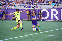 Orlando, Florida - Sunday, May 8, 2016: Orlando Pride forward Alex Morgan (13) has her cross blocked by Seattle Reign FC defender Kendall Fletcher (13) during a National Women's Soccer League match between Orlando Pride and Seattle Reign FC at Camping World Stadium.