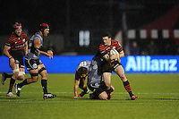 Duncan Taylor of Saracens is tackled during the Sanlam Private Investments Shield match between Saracens and the Cell C Sharks at Allianz Park on Saturday 25th January 2014 (Photo by Rob Munro)