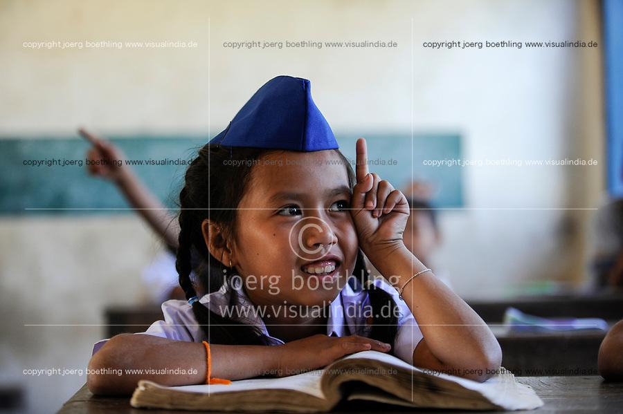 LAOS , Province Vientiane, village Tham , children in school, girl in school uniform of the communist Pioneer movement / Kinder in einer Dorfschule in Kleidung der kommunistischen Pionierorganisation