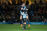 Jason McCarthy of Wycombe Wanderers celebrates victory on the final whistle with Luke O'Nien of Wycombe Wanderers during the Sky Bet League 2 match between Wycombe Wanderers and Oxford United at Adams Park, High Wycombe, England on 19 December 2015. Photo by Andy Rowland.