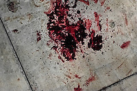 A pool of blood seen on the floor after a shooting incident between gang members and police on the street in a gang neighbourhood of San Salvador, El Salvador, 15 December 2013. Although the murder rate in the country has dropped significantly, after a truce between two major street gangs (Mara Salvatrucha and Barrio 18) was agreed in 2012, the lack of security and violence are still the main issues in people's daily life. Due to the fact the gangs have never stopped their criminal activities (extortions, distribution of drugs and kidnappings), the Police anti-gang forces keep running their operations and chasing the 'homeboys' (how the gang's foot soldiers usually call themselves) in the poor, socially deprived suburbs of Salvadoran cities.