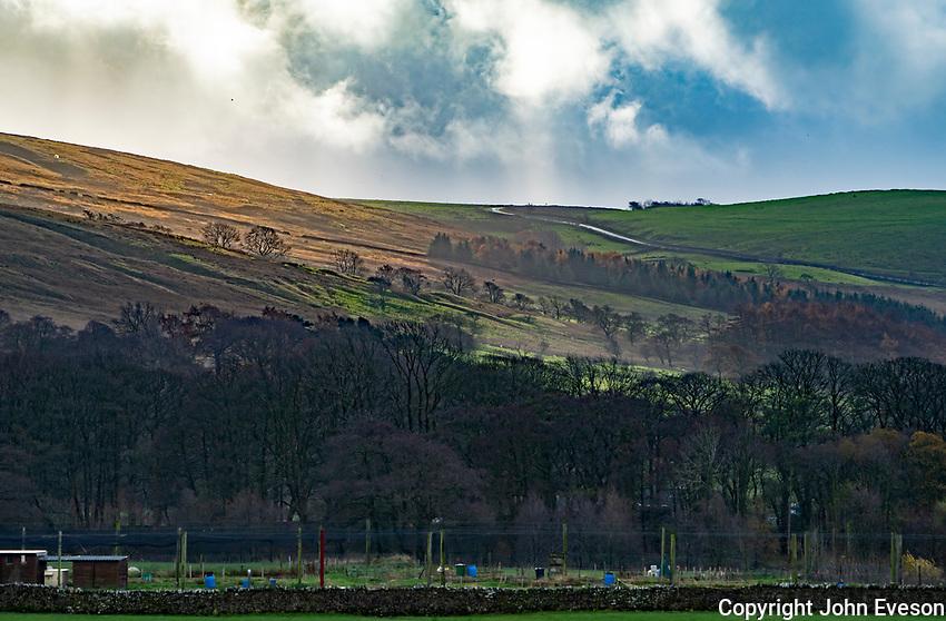 Sun hitting the hills above the fish farm at Dunsop Bridge, Clitheroe, Lancashire.