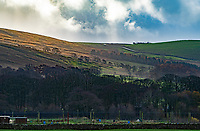 Sun hitting the hills above the fish farm at Dunsop Bridge, Clitheroe, Lancashire.