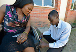 Lucky Chirambaterere adjusts Hope Ranganayi's wheelchair at the National Rehabilitation Centre in Ruwa, Zimbabwe. The Centre assembles and fits wheelchairs provided by the Jairos Jiri Association with support from CBM-US.