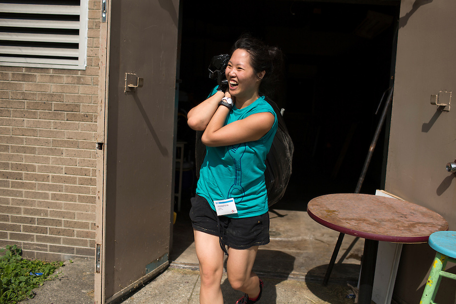 """Josephine Lukito removes trash during """"Circle the City with Service,"""" the Kiwanis Circle K International's 2015 Large Scale Service Project, on Wednesday, June 24, 2015, at the Friendship Westside Center for Excellence in Indianapolis. (Photo by James Brosher)"""
