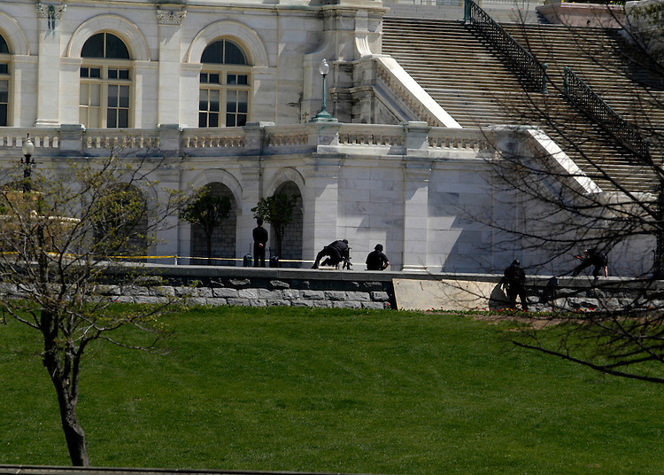 U.S. Capitol Police swat team members respond to a man with two suspicious packages on the West Front of the Capitol.