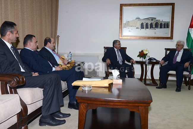 Palestinian President Mahmoud Abbas meets with director general of the Arab Organization for Administrative Development of the Arab League, Refaat Abdel-Halim Faouri , at Abbas's headquarter, in the West Bank City of Ramallah, December 29, 2013. Photo by Thaer Ganaim