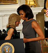 First lady Michelle Obama exchanges places with Dr. Jill Biden, as she prepares to deliver remarks to the National Governors Association during a meeting in the White House State Dining Room, on Monday, February 27, 2012, in Washington, DC.  .Credit: Leslie E. Kossoff / Pool via CNP