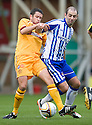 MOTHERWELL'S TIM CLANCY AND KILMARNOCK'S GARY HARKINS CHALLENGE FOR THE BALL