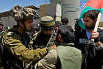 A Palestinian tussles with Israeli soldiers during a demonstration at the entrance to the village of Beit Ummar near Hebron on 05.06.2010. The demonstrators were protesting against the shooting of two boys from the nearby Al 'Arrub refugee camp by an Israeli settler, the Israeli raid on the Mavi Marmara aid ship that resulted in 9 deaths & the blockade of Gaza by Israel & Egypt.